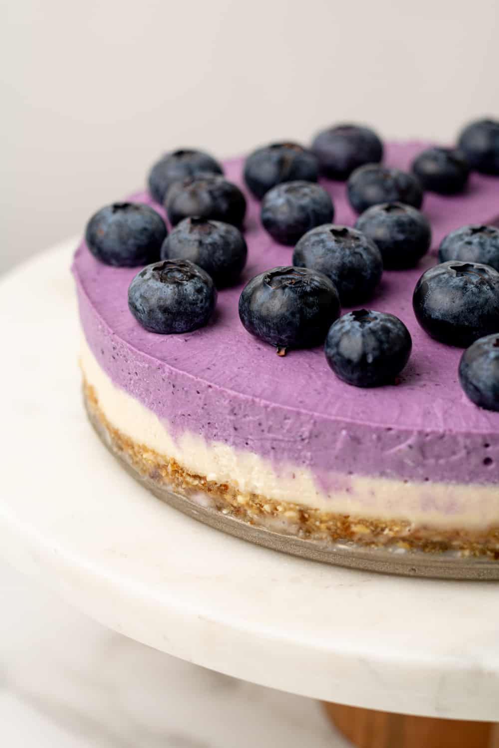 Close up image of the side of the blueberry cheesecake
