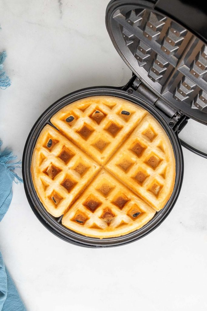 waffle cooking in the waffle maker