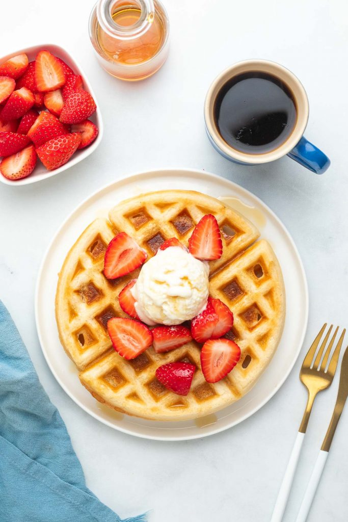 waffles with fruit, ice cream and maple syrup