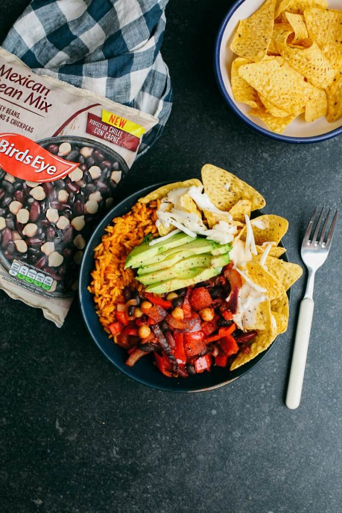 Vegan Bean Chili Nacho Bowl by Wallflower Kitchen. Are you going vegan for a month this January? Here are 31 easy vegan recipes to try this veganuary!